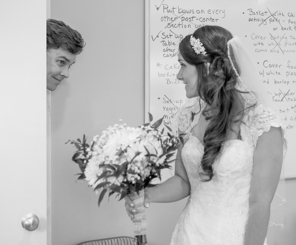 """Craig stopping by the wedding """"command center"""" (kitchen/supply room)."""